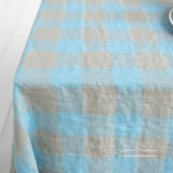 100% linen tablecloth in sky blue and grey.