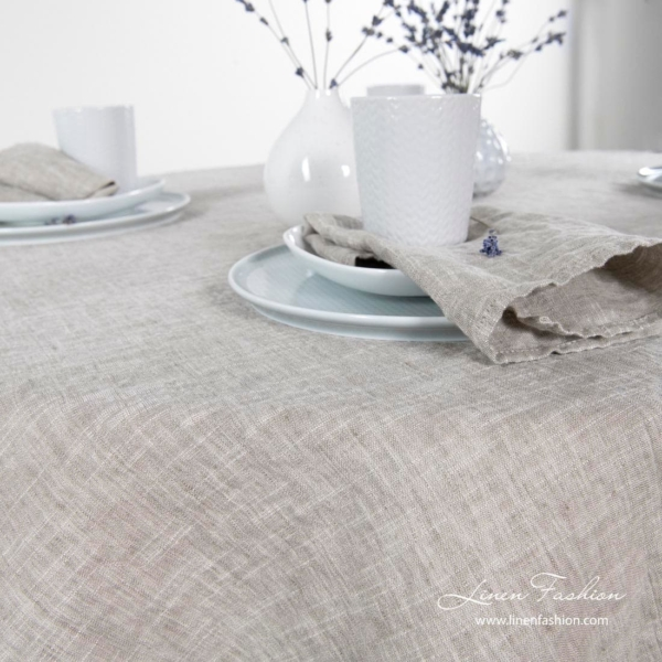 Linen-cotton round tablecloth in light grey.