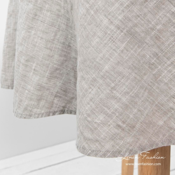 Light grey colored round tablecloth, astra.