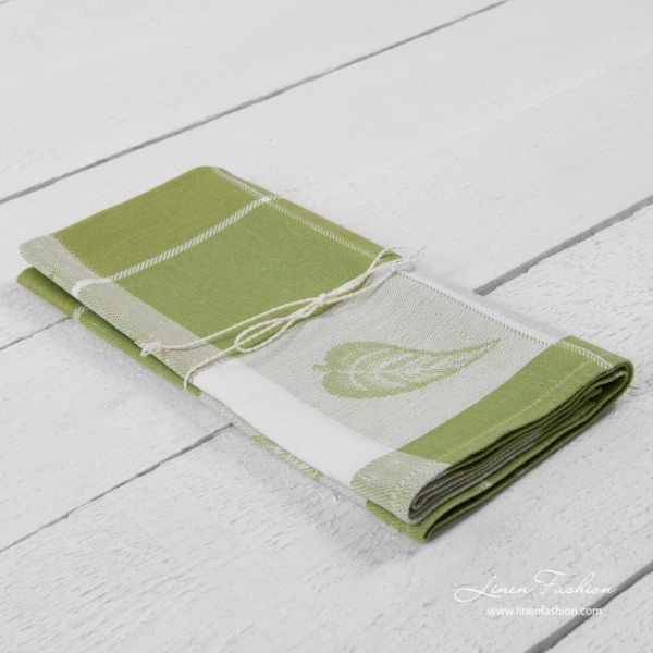 Kitchen towel in light green color.