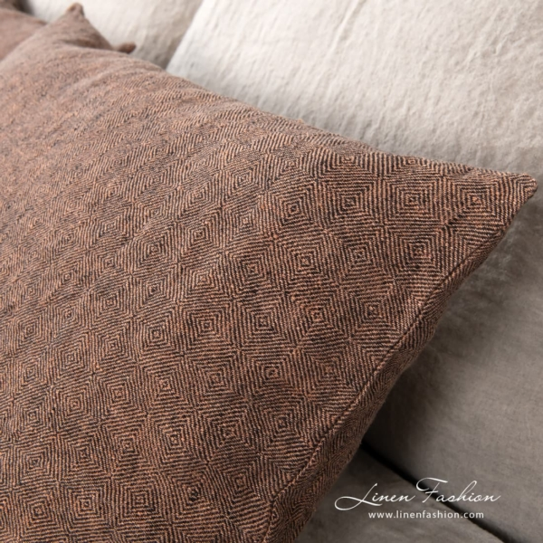 Linen cushion cover in brown color.