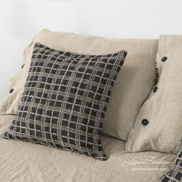 Linen cushion cover in grey color, focus.
