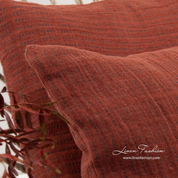 Cushion cover in red color, terra.