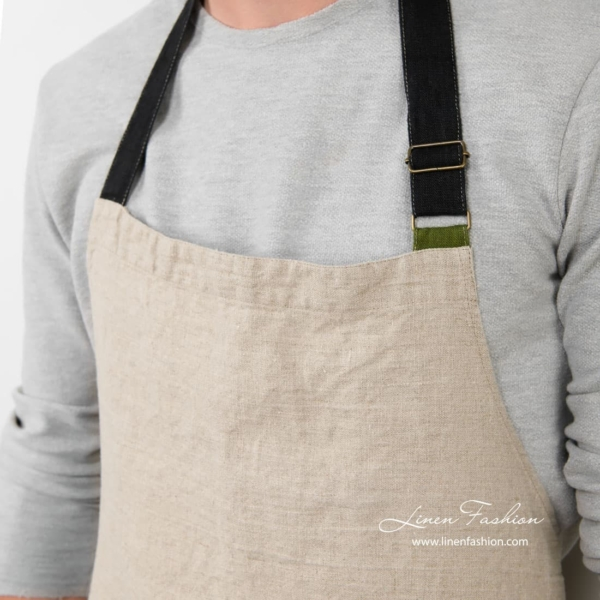 Grey colored apron of linen fabric.