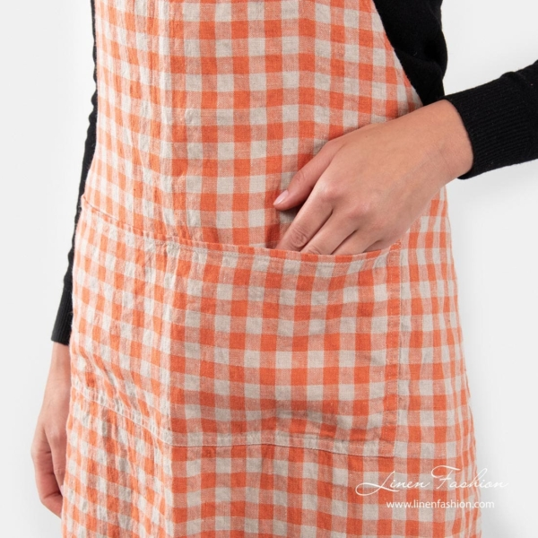 Linen apron in orange color, gamma.