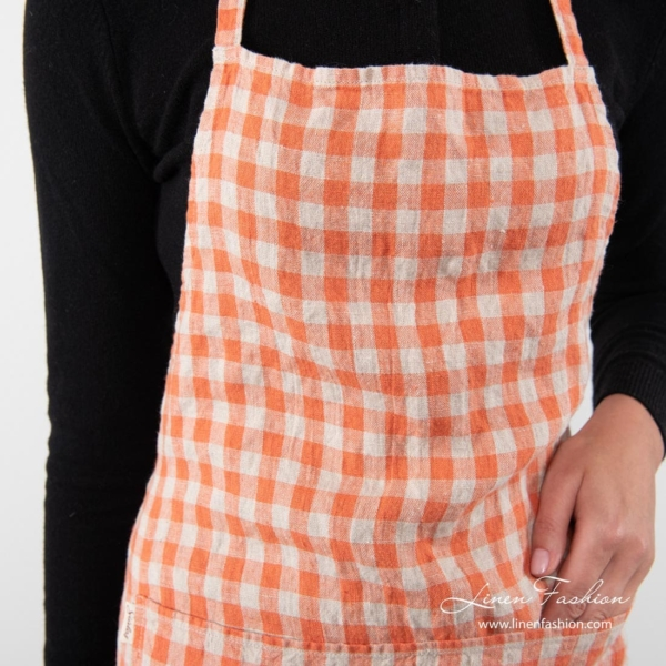 100% linen apron in orange.