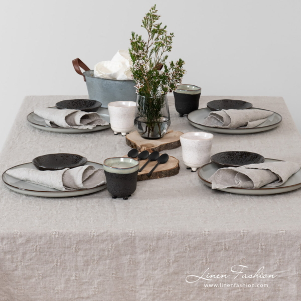 Linen tablecloth in grey color.