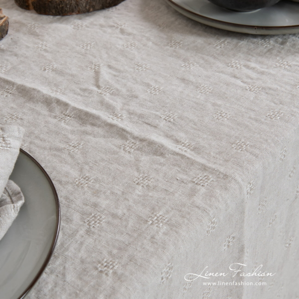 Solo grey colored tablecloth.