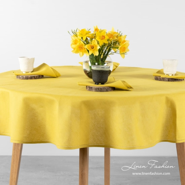 Round(oval) tablecloth in yellow color.