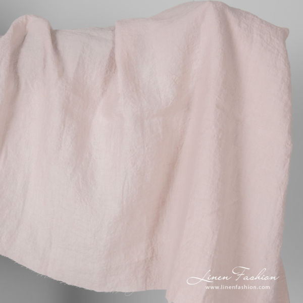 Wide width linen fabric in light pink colour, washed