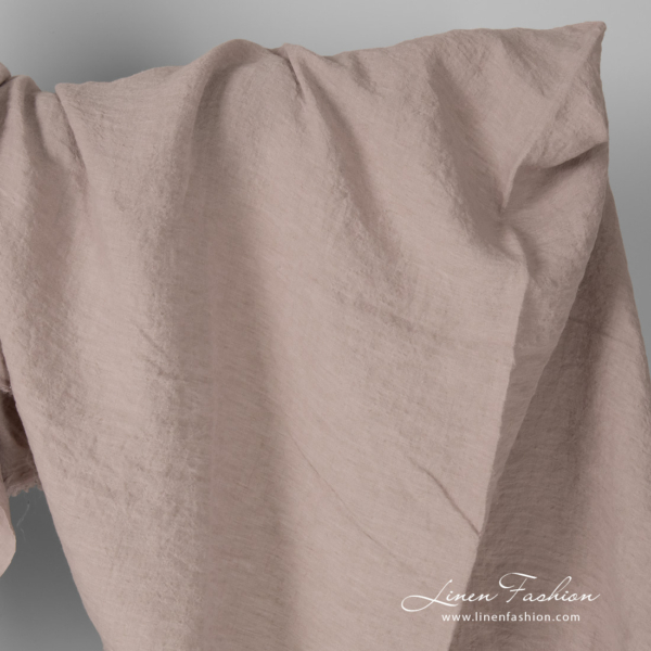 Wide linen fabric in smokey rose colour, washed