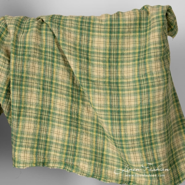 Wide green checked linen fabric, washed