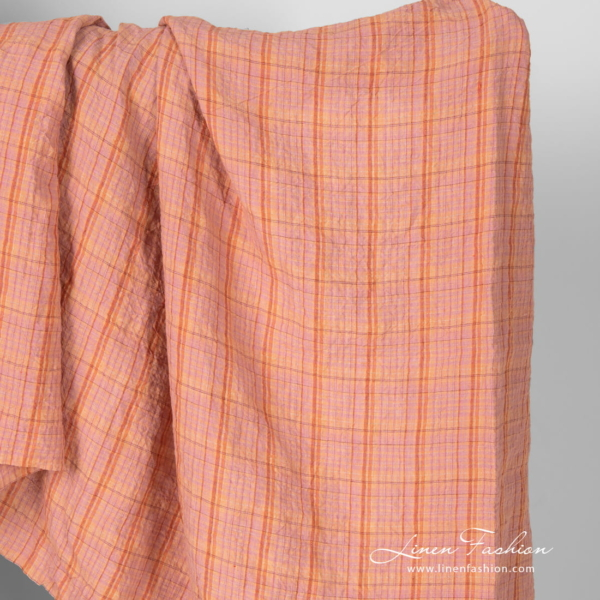 Wide light orange checked linen fabric, washed