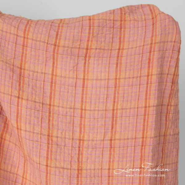 Washed wide linen fabric in light orange and lilac checks