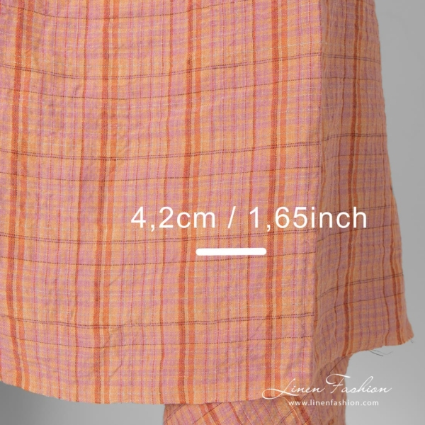 Wide linen fabric in orange, lilac coloured checks size info