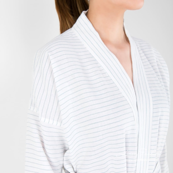 Womens bathrobe in white with greenish stripes.