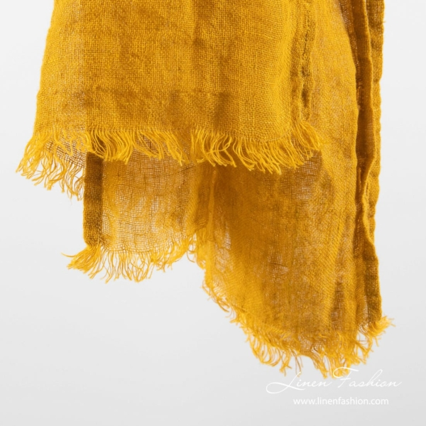 Yellow colored linen shawl.