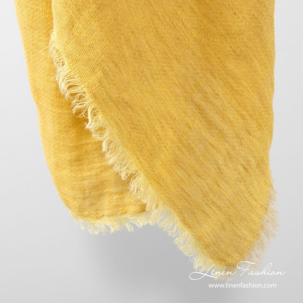 Yellow colored linen scarf.