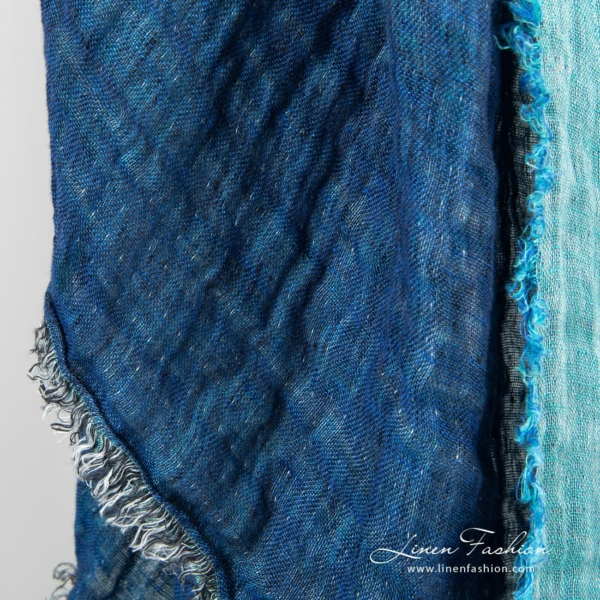 Blue colored linen scarf.