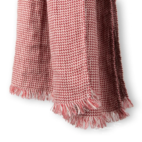 Red/grey colored linen shawl.