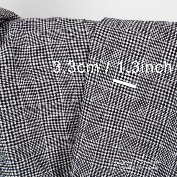 Washed black and white checked linen wool fabric