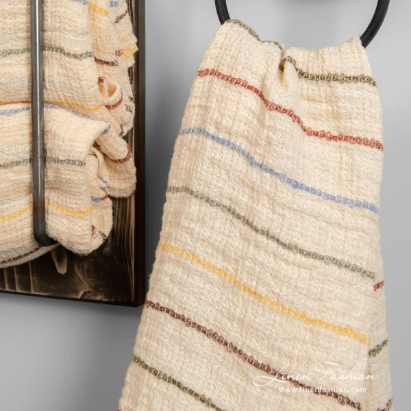 Waffle weave yellowish linen towel with coloured stripes